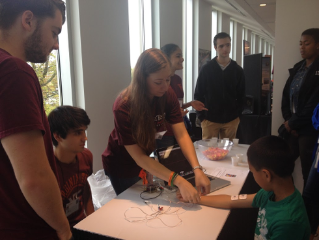 Neuroscience Club sets up a booth at Virginia Science Festival to educate children on the action potentials in their muscles.