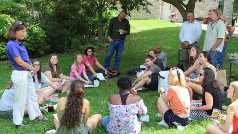 students meeting with faculty at Virginia Tech  outside building.